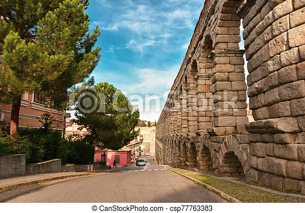 Ancient Roman Aqueduct in Segovia Spain - csp77763383