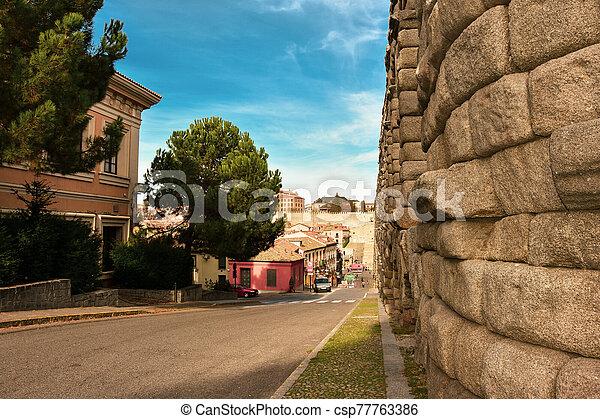 Ancient Roman Aqueduct in Segovia Spain - csp77763386