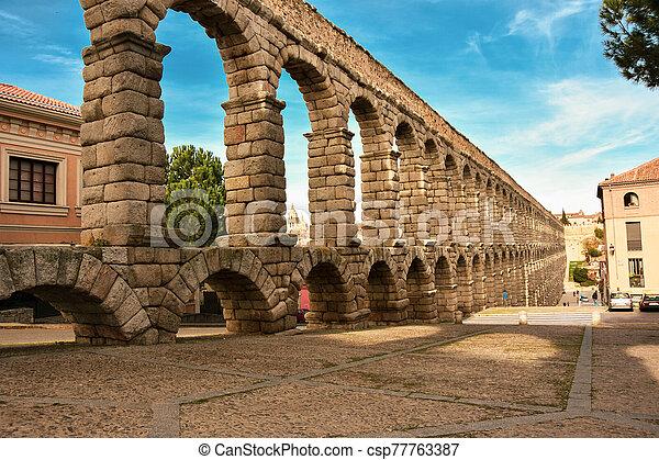 Ancient Roman Aqueduct in Segovia Spain - csp77763387