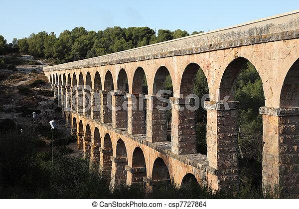 Ancient roman aqueduct in Tarragona, Spain - csp7727864
