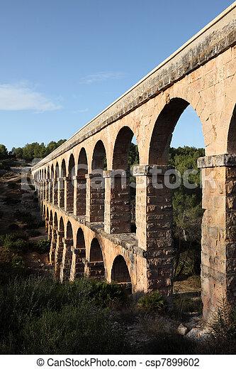 Ancient roman aqueduct in Tarragona, Spain - csp7899602