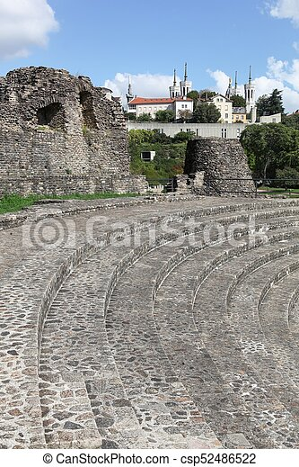 Ancient roman theater of Fourviere with the basilica of Fourviere in Lyon, France - csp52486522