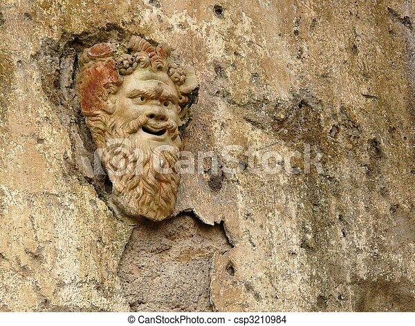 Ancient stone mask at Herculaneum, Italy - csp3210984