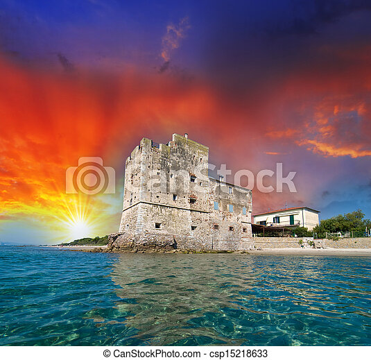 Ancient Tower over the Ocean at sunset - csp15218633