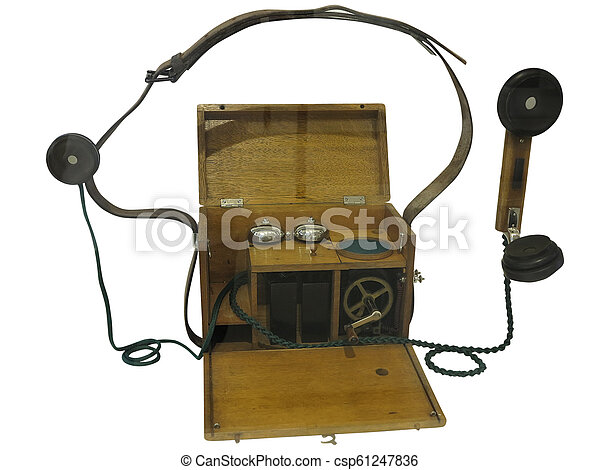 Ancient vintage wooden phone from the beginning of 20 century, isolated on white background - csp61247836