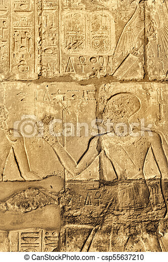Ancient wall with egyptian hieroglyphs in the karnak temple ...