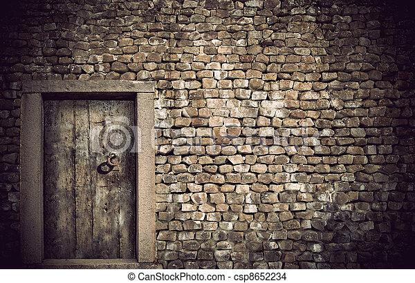 Ancient wooden door - csp8652234