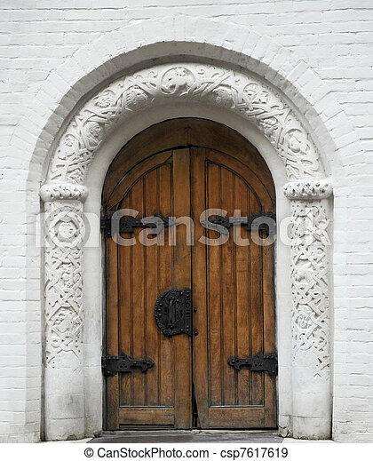 Ancient wooden door with metal doorknob and hinges stock photographs ...