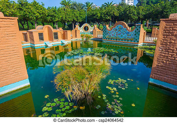 Andalusian style nice pond in the park of Malaga, Spain - csp24064542