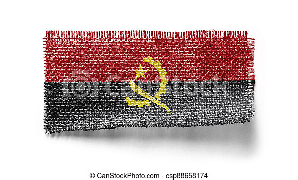 Angola flag on a piece of cloth on a white background - csp88658174