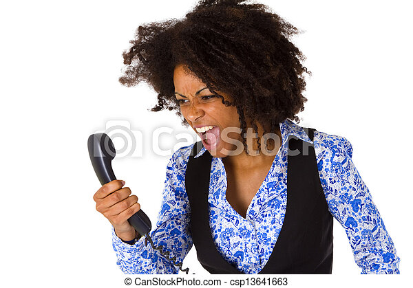 Angry african american woman with handset - csp13641663