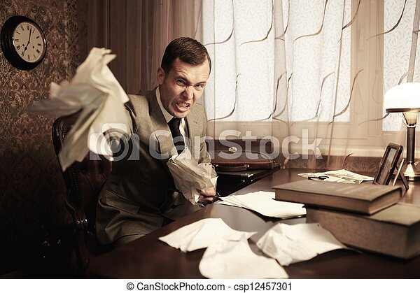 Angry businessman rumples a documents - csp12457301