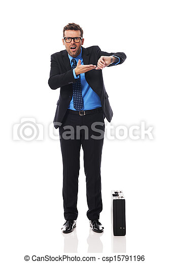 Angry businessman waiting for late business partner - csp15791196