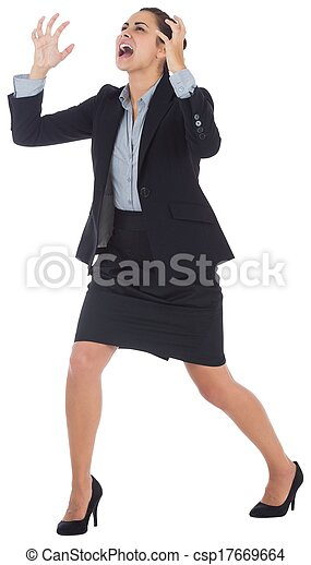 Angry businesswoman gesturing - csp17669664