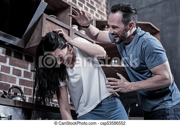 Angry drunk man beating his wife - csp53586552