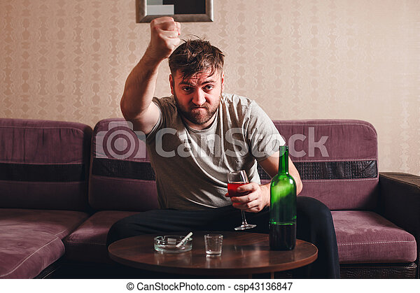 Angry drunk man in depression. - csp43136847