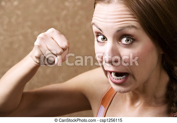 Angry Woman Throwing a Punch - csp1256115