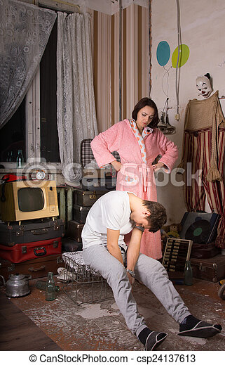 Angry Woman Watching her Sleeping Partner - csp24137613