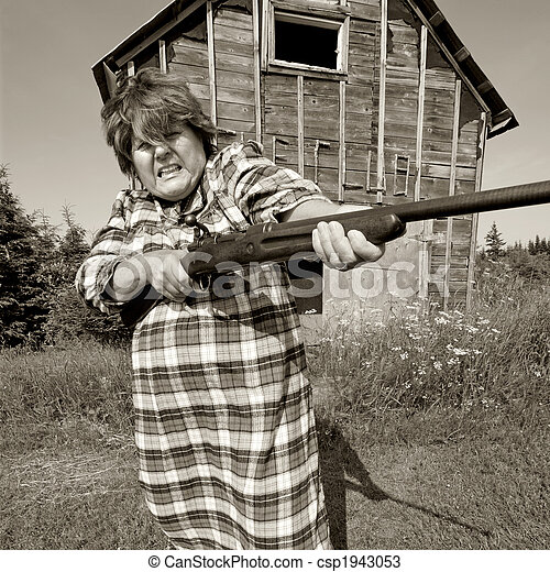 Angry woman with big gun - csp1943053
