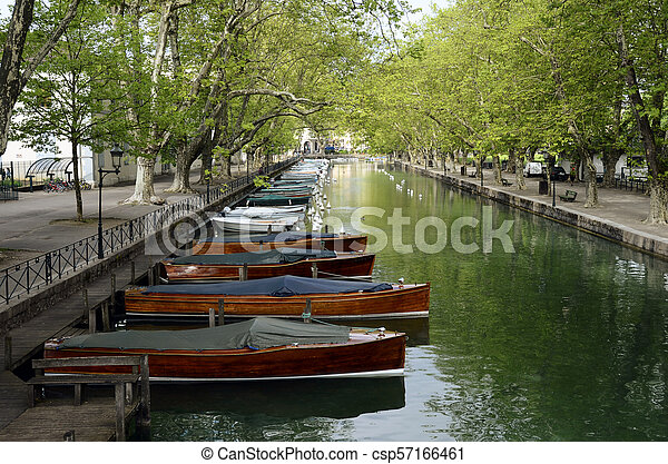 Annecy city, Thiou canal and wooden boats, Savoy, France - csp57166461