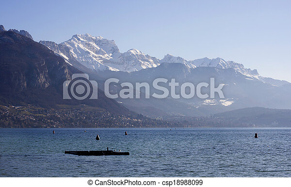 ANNECY, FRANCE : December 25, 2011 : Annecy lake and mountains on winter morning in France. - csp18988099