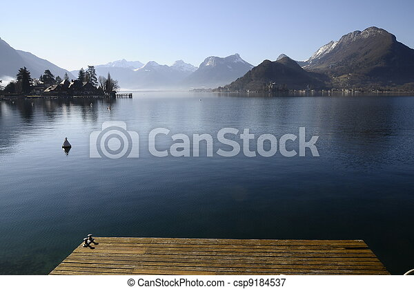 Annecy lake from Talloires harbour and wooden pontoon on morning - csp9184537