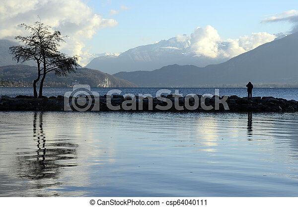 Annecy lake landscape, snow on mountains, Savoy, France - csp64040111