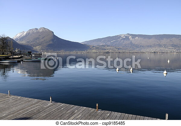 Annecy lake, mountains and reflection in water, view from talloires - csp9185485