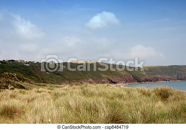 Anonymous people on a beach in Devon - csp8484719