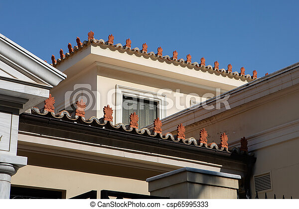 Antefixes, traditional carved ornaments - csp65995333