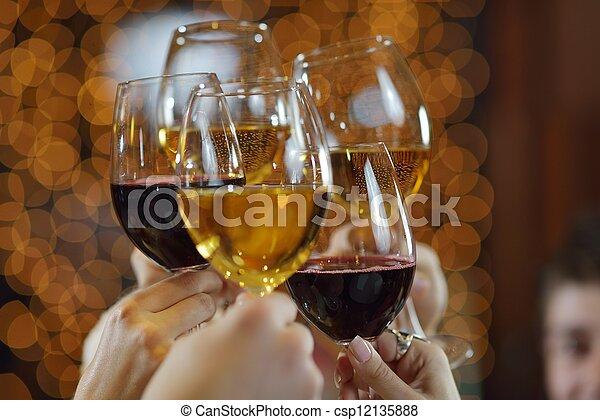 Manos sosteniendo las copas de champán y vino - csp12135888