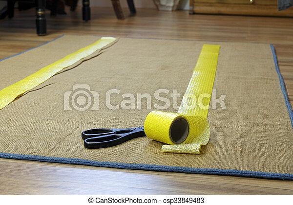 Anti-Slip Rug Tape and Scissors - csp33849483