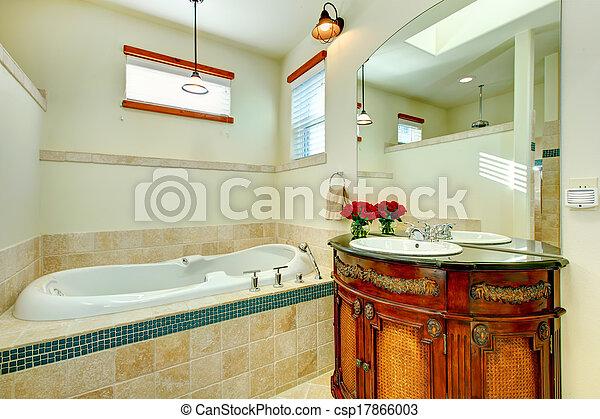Elegante baño moderno con un armario de almacenamiento de madera antiguo - csp17866003