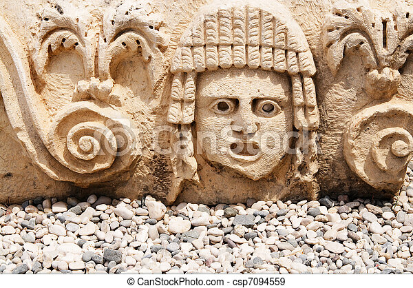 Antique, abandoned masks on the stage in ancient theatre. - csp7094559