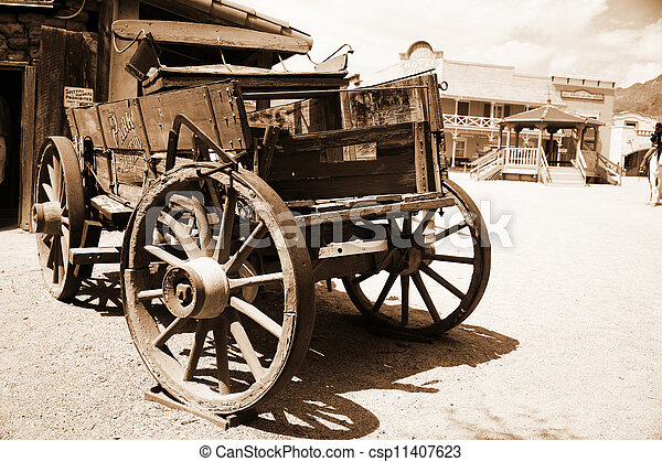 Antique american cart in old western city - csp11407623