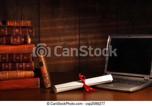 Antique books, diploma with laptop on desk - csp2086277
