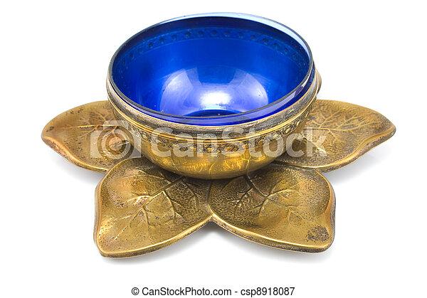 Antique brass pot with blue glass - csp8918087
