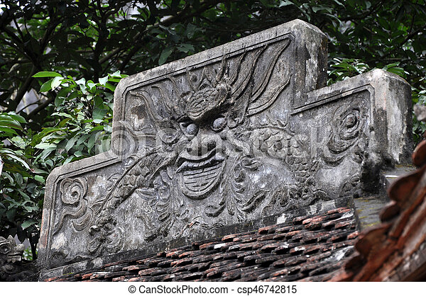 Antique carving in stone with mythical motif. Bich Dong pagoda, Vietnam - csp46742815