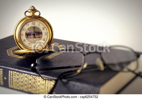 Antique clocks and book - csp6254752
