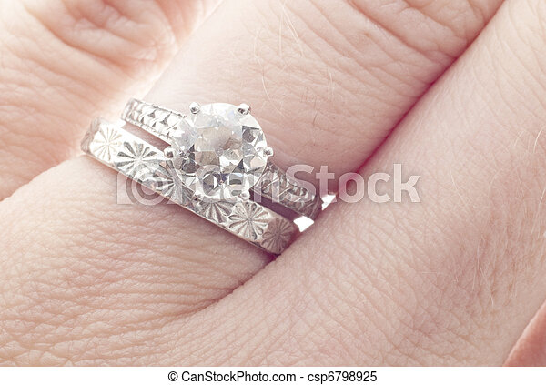 Antique Diamond Wedding Ring and Band on Finger  - csp6798925
