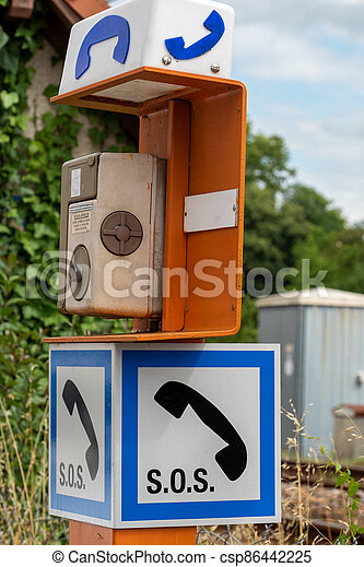 Antique emergency telephone in french train station - csp86442225