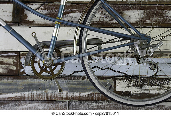 Antique old bicycle on the wall - csp27815611