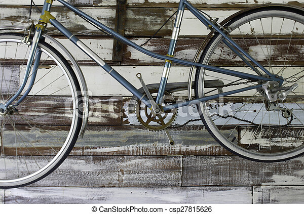 Antique old bicycle on the wall - csp27815626