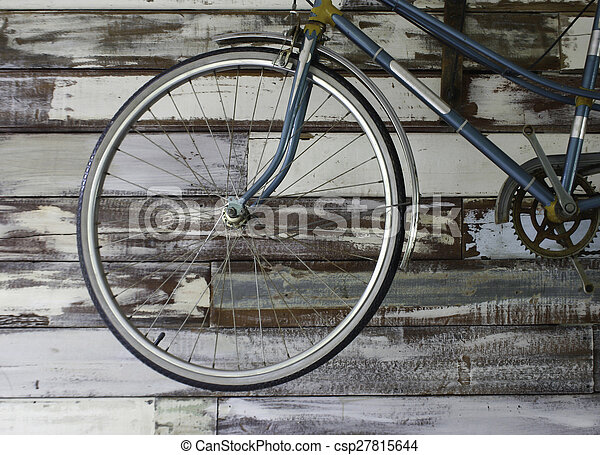 Antique old bicycle on the wall - csp27815644