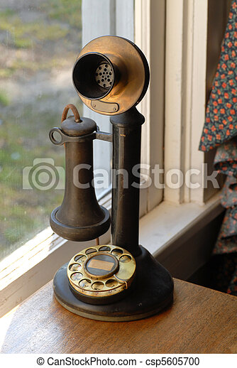 Antique old style telephone lit with natural light - csp5605700