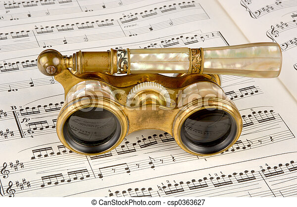 Antique Opera Glasses on a Music Score - csp0363627