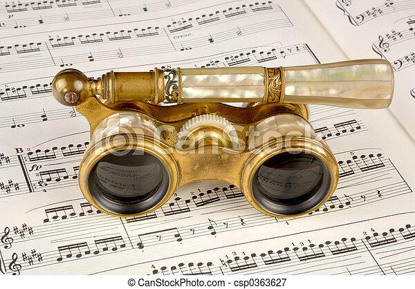 Antique Opera Glasses on a Music Score - csp0363627