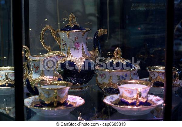Antique porcelain coffee set in show case - csp6603313