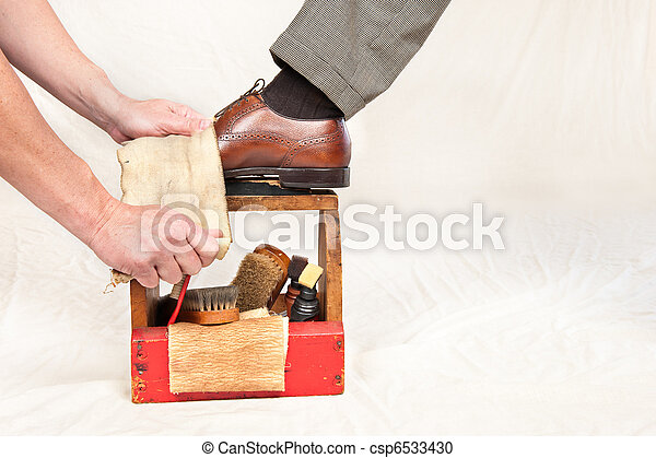 Antique shoe shine box and worker - csp6533430