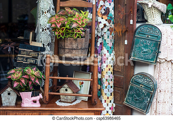 Antique shop window with various odds & ends - csp63986465